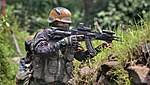 Indian Army personnel with a Mod. Ak rifle.jpg