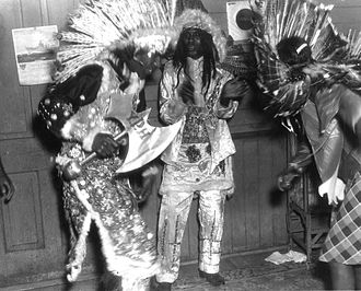 """Mardi Gras Indians - Chief and members of the """"Yellow Pocahontas"""" tribe, St. Joseph's Day, 1942"""