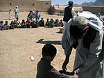 Infantrymen distribute supplies to Afghan community DVIDS157054.jpg
