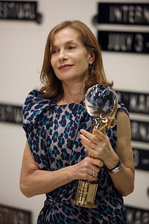 Isabelle Huppert - Huppert poses with Special Crystal Globe for outstanding artistic contribution to the world cinema at 44th Karlovy Vary International Film Festival