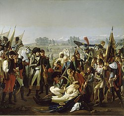 Oil painting featuring Napoleon in the foreground being presented by a soldier the body of Desaix. Desaix is wearing a white shirt and his chest is exposed to show the wound. Numerous and curious bystanders surround the scene.