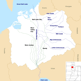A map of Salt Lake County showing a river running from a lake in the south to a lake in the north.  Canals branch off the river.  Other creeks enter from the east. In the lower right corner is a map of Utah with a colored-in portion in the northern middle showing the location of Salt Lake County.