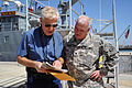 Journalist David Henley, left, speaks with U.S. Army Col. Robert White, the 311th Sustainment Command's chief of staff, on board the Landing Craft Utility 2032 in Port Hueneme, Calif., March 22, 2013 130322-A-IO170-015.jpg