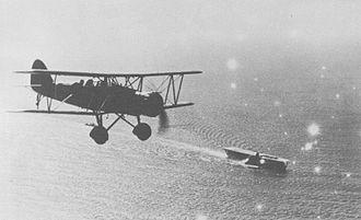 Yokosuka B4Y - A Type 96 flies near the aircraft carrier Kaga off China in 1937 or 1938.