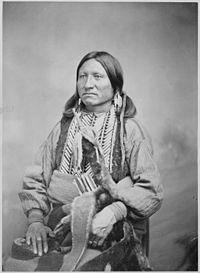 Kicking Bird (Tene'-angpote), a Kiowa chief and grandson of a Crow captive, three-quarter-length, seated, 1868 - 1874 - NARA - 518902.jpg