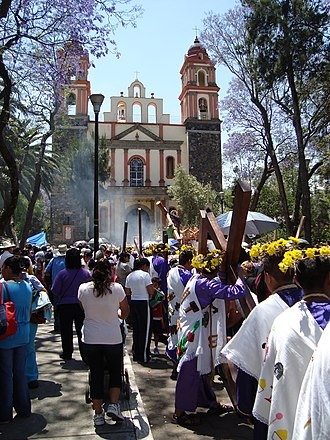 Holy Week in Mexico - Procession with crosses at the La Cuevita church in Iztapalapa
