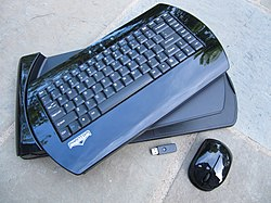 Black wireless keyboard with thumb drive and wireless mouse