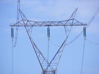 Electricity sector in Canada - A Mae West pylon from an Hydro-Québec TransÉnergie 735 kV power line, recognizable by the x-shaped spacers separating the three 4-conductor sets. Its introduction, in 1965, facilitated large-scale power developments on the North Shore, in Northern Quebec and in Labrador.