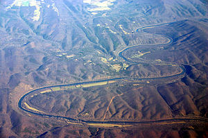 Little Orleans, Maryland - Oblique air photo of the meandering Potomac River at Little Orleans (center), facing north. The photo shows Allegany County, Maryland (left), Morgan County, West Virginia (right), Sideling Hill (right), and the Chesapeake and Ohio Canal.