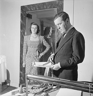 Norman Hartnell - Hartnell at work in his London studio during wartime source: IWM