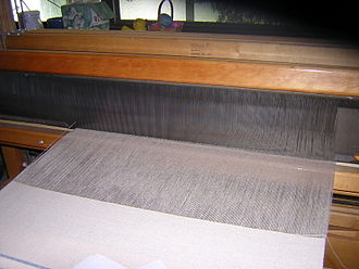 Reed (weaving) - The reed is the part in the beater that the warp threads go through.