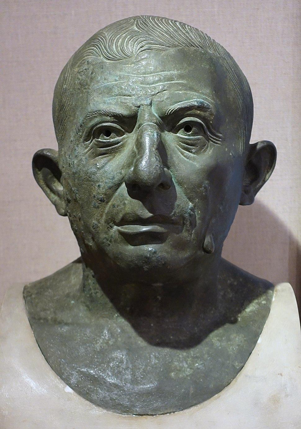 Lucius Caecilius Iucundus, plaster cast of Roman bronze and marble original, House of Caecilius Iucundus (V-i-26), Pompeii, c. 79 AD, National Archaeological Museum, Naples - Spurlock Museum, UIUC - DSC05672 (cropped)