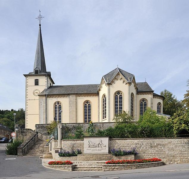 Luxembourg, Hobscheid: church and World War II Memorial.