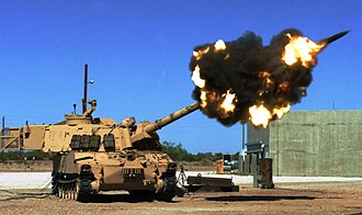 Yuma Proving Ground - Yuma Test Center's Ground Combat Systems test-fires a M109A6 Paladin at a YPG artillery range