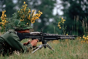 M60 machine gun - A camouflaged infantryman armed with an M60 machine gun.