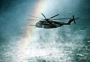 HM-15 - A rainbow is formed in the mist rising from the ocean as an HM-15 MH-53E conducts mine countermeasures operations near Naval Air Station Alameda, 1990.