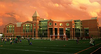 Marshall University - Marshall University Recreational Center complete with indoor pool, basketball courts, racquetball courts, exercise equipment, hanging indoor track, and artificial rock climbing wall (2009)