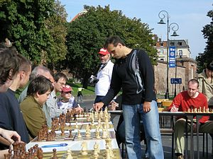 Glossary of chess - A simultaneous exhibition