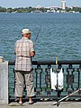 Man Fishing on Dnieper Riverfront - Dnipropetrovsk - Ukraine (44088393162).jpg