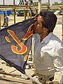 Man Kisses Flag of Third Shia Imam - Outside Holy Shrine of Imam Khomeini - Tehran - Iran (7380701968).jpg