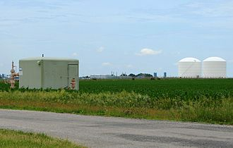 Natural gas - Peoples Gas Manlove Field natural gas storage area in Newcomb Township, Champaign County, Illinois. In the foreground (left) is one of the numerous wells for the underground storage area, with an LNG plant, and above ground storage tanks are in the background (right).