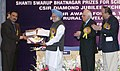 Manmohan Singh giving away the Shanti Swarup Bhatnagar Prize for Science and Technology 2008 to Dr. Jarugu Narasimha Moorthy of Kanpur for his outstanding contribution in Chemical Sciences, in New Delhi on December 20, 2008.jpg