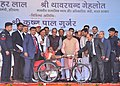 Manohar Lal Khattar and the Minister of State for Social Justice & Empowerment, Shri Krishan Pal distributing the Aids and Equipments to Divyangjans, at ADIP-SPL Distribution Camp, in Faridabad, Haryana.jpg