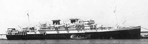 USS Rochambeau (AP-63) - Ex-USS Rochambeau (AP-63) being operated for the WSA by the French Government as Marechal Joffre to transport U.S. troops from Europe to the States after the War. Note the extra life rafts along her starboard side.