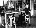 Marie Curie on a chair in her laboratory.jpg