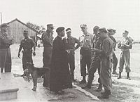Marine officers visit Father Phuoc's village during the Vietnam War.jpg