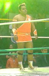 A color photo of Máximo Sexy standing in a wrestling ring