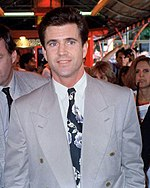 A man is seen wearing a grey suit