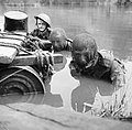 Members of the Doncaster Home Guard, two wearing camouflage net veils over their faces, swim across a river during an assault exercise, 20 July 1942. H21585.jpg