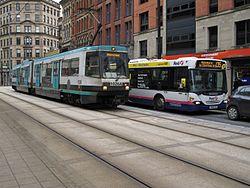 Metrolink tram & First bendy bus, Manchester, 2011-03-12.JPG