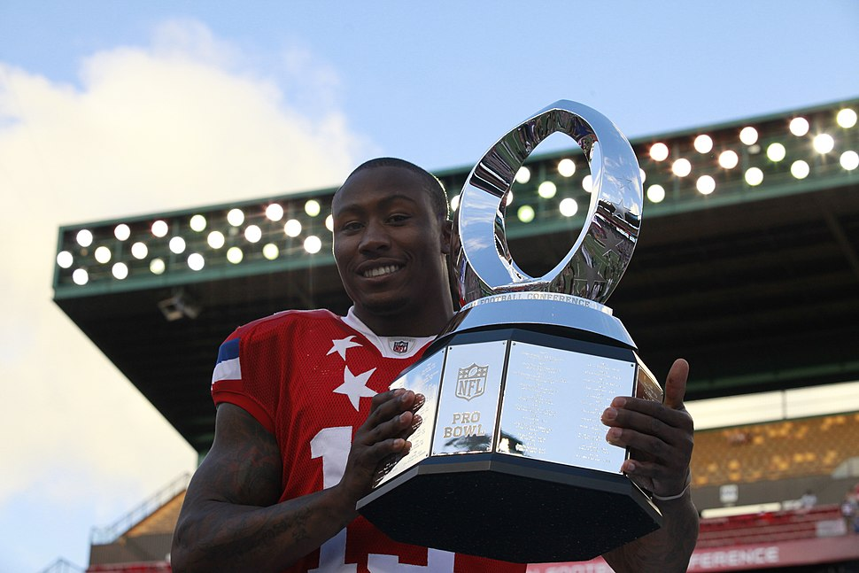 Miami Dolphins football team wide receiver Brandon Marshall receives the National Football League's 2012 Pro Bowl Most Valuable Player trophy at Aloha Stadium in Honolulu Jan 120129-M-DX861-231