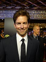 Actor Michael Muhney, smiling in a suit