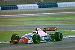 Michele Alboreto - Minardi M194 at the 1994 British Grand Prix (32541371645).jpg