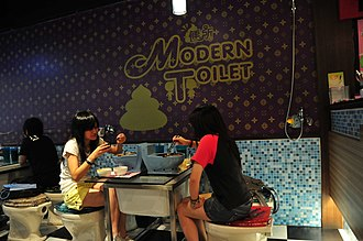 Theme restaurant - Two diners eating at Modern Toilet restaurant