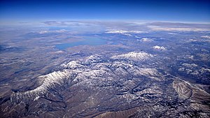 Mount Nebo (Utah) - Mount Nebo (left of center) aerial view from the south, with Utah Lake and the rest of the Wasatch Range in the background; the Great Salt Lake on he far left horizon