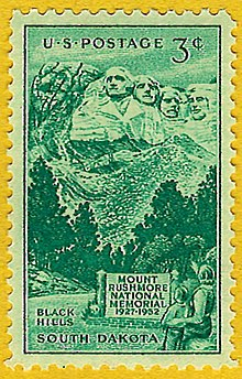 Green 3-cent postage stamp showing people looking at Mount Rushmore