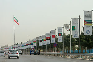 16th Summit of the Non-Aligned Movement - Flags of countries in attendance along with the motto put up for the summit in Tehran