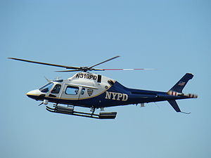 English: NYPD helicopter patrolling New York C...