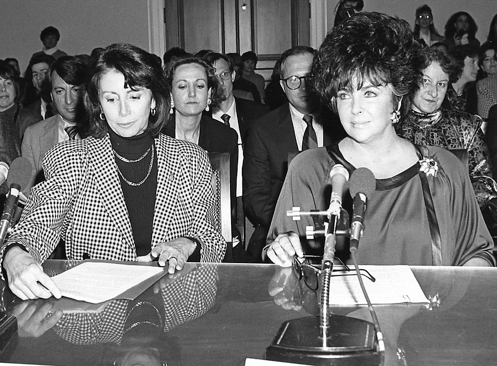 Nancy Pelosi and Elizabeth Taylor Testifying Before the House Budget Committee on HIV-AIDS Funding (5978837887) (cropped)