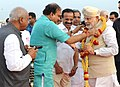 Narendra Modi being received by the Union Minister for Chemicals and Fertilizers, Shri Ananthkumar, on his arrival, at the HAL airport, Bangalore. The Union Minister for Railways.jpg