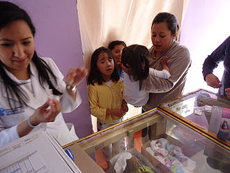 Immunization - Medical student participating in a polio vaccine campaign in Mexico