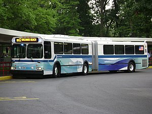 207th Street Crosstown Line - A New Flyer D60 high-floor bus on the Bx12 SBS at Orchard Beach in 2008. High-floor buses are no longer present in SBS service, which no longer serves Orchard Beach.
