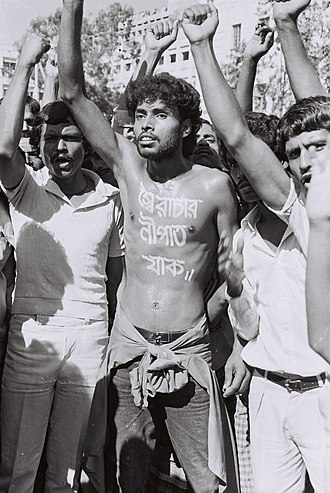 History of Bangladesh after independence - Bangladeshi pro-democracy activist Noor Hossain photographed by Dinu Alam before he was killed, protesting the autocratic rule of Hussain Muhammad Ershad.