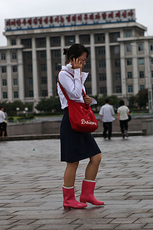 Koryolink - Woman using Koryolink mobile phone network in Pyongyang
