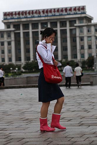 Koryolink - Woman using Koryolink mobile phone network in Pyongyang