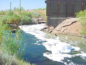 Environmental issue - Water pollution is an environmental issue that affects many water bodies. This photograph shows foam on the New River as it enters the United States from Mexico.
